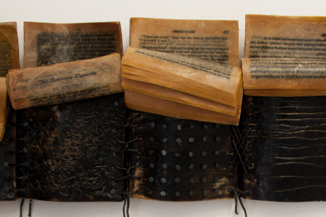 "Kim Bruce - Bedtime Stories,  Encaustic, furniture tacks & string on a books,  7""h  x 21""w x 3""d"