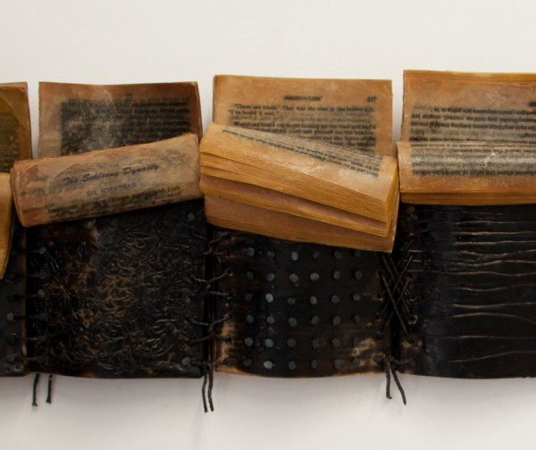 "Kim Bruce - Bedtime Stories,  Encaustic, furniture tacks & string on a books,  7""h  x 21""w x 3""d"